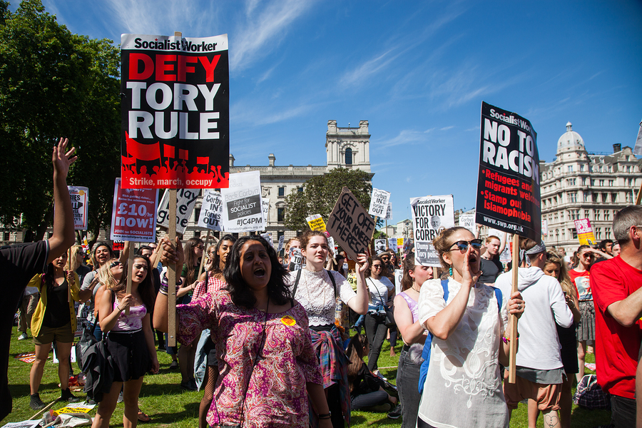 London, UK - June 10 2017: Unidentified protesters at Westminster Palace expressing their anger at Theresa May's government and her alliance with the Democratic Unionist Party, London, UK