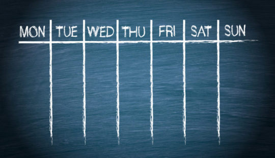 Weekly Calendar on blue chalkboard background with text
